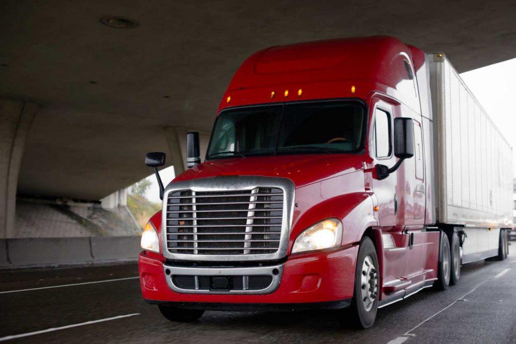 Bright-red-big-rig-semi-truck-with-dry-van-trailer-driving-on-highway-under-bridge-across-the-road-939457318_1256x838<dataavatar hidden data-avatar-url=https://secure.gravatar.com/avatar/7a785b3b06a58511717183a13a93c1cb?s=96&d=mm&r=g></dataavatar>